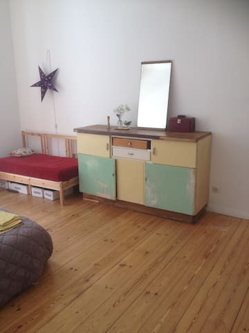 Small canapé and vintage sideboard