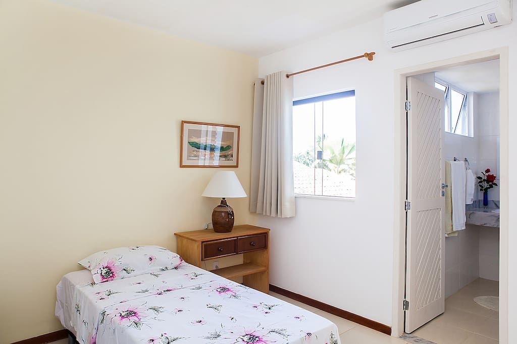 Here is your comfortable bedroom with air conditioning and view over garden. Your room has a private bathroom within it and is located on the first floor.