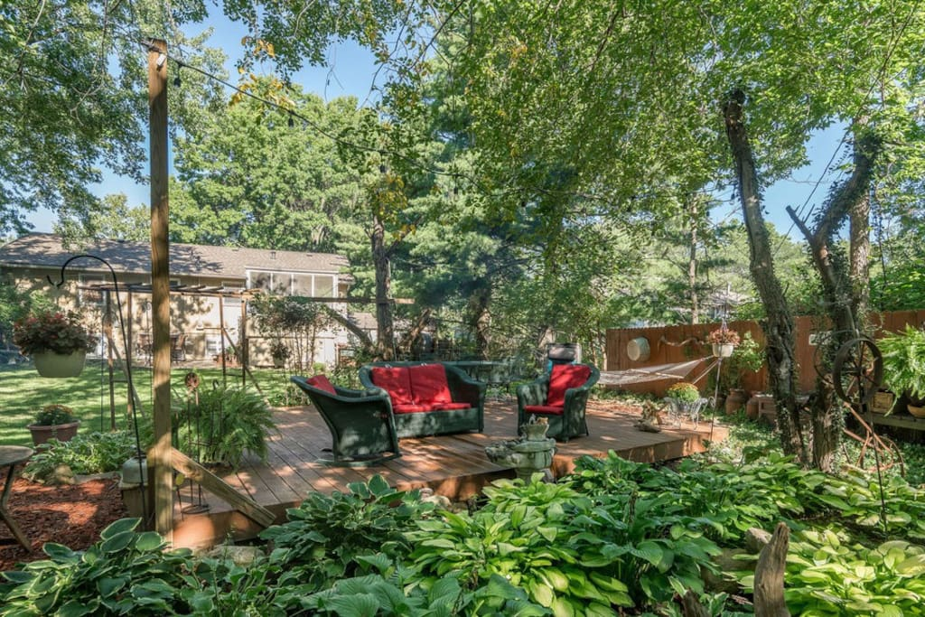 Back yard retreat with a fountain and hosta gardens.