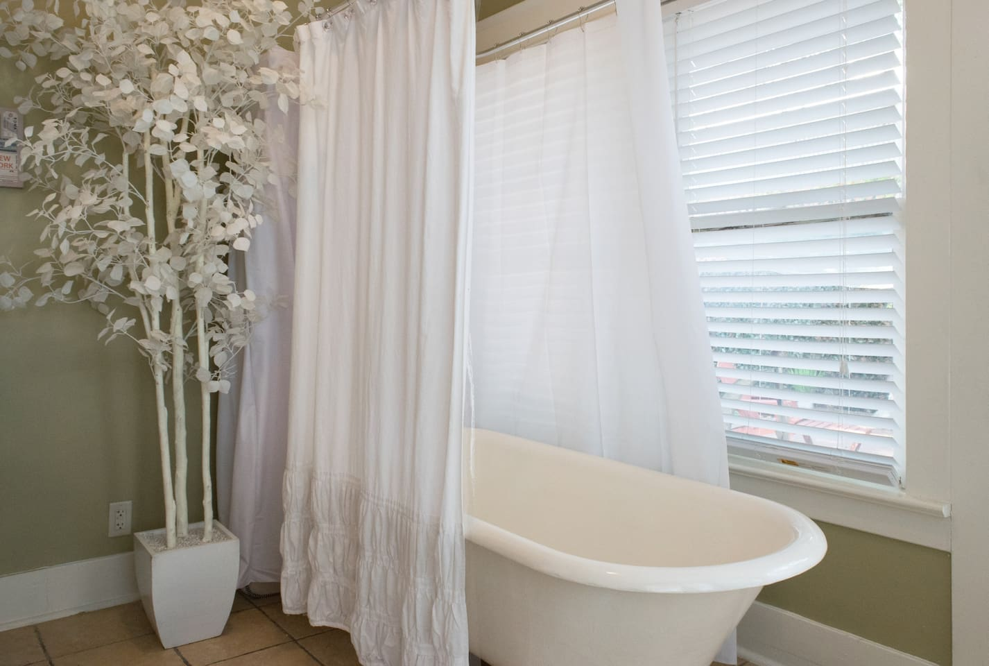 clawfoot tub with shower - open the blinds and you will feel you are showering outside