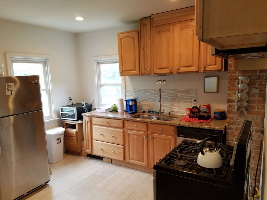 Kitchen with all stainless steel appliances, wine chiller and breakfast and coffee station