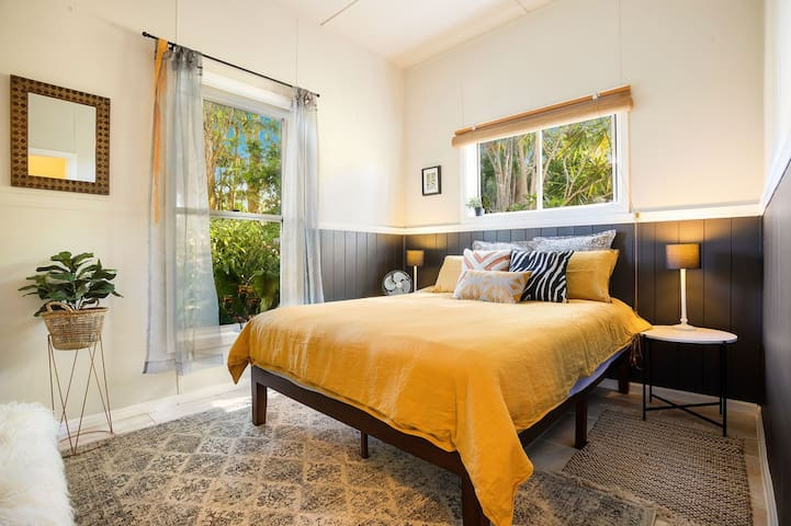 2nd bedroom with tropical garden views
