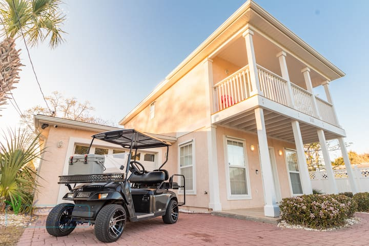 Charming 2 bedroom beach cottage with golf cart.  Free daily activities included
