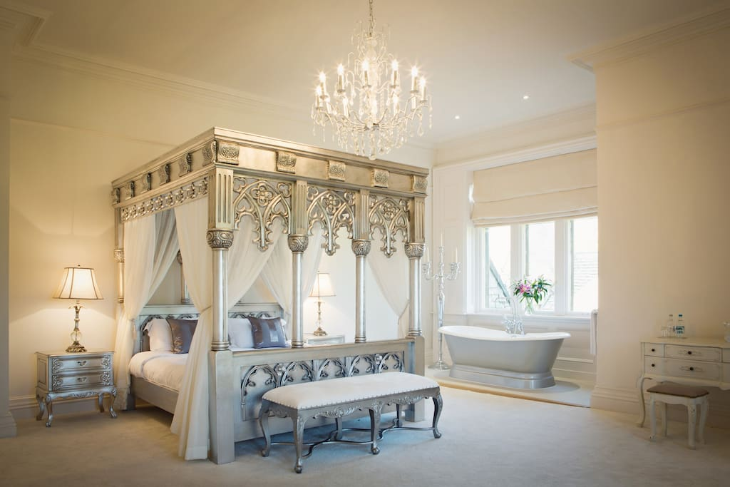 Room 1 - Our Showcase Manor Suite features an imposing king size four poster bed with a contemporary twist