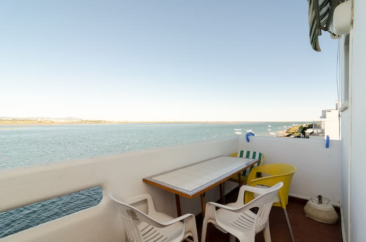 Balcony with amazing views to the Natural Reserve and its lagoon. It has table, chairs and awning to provide a nice shade.