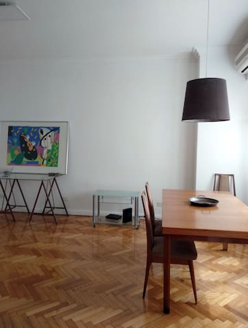Living / dining room accentuated with modern artwork and details.