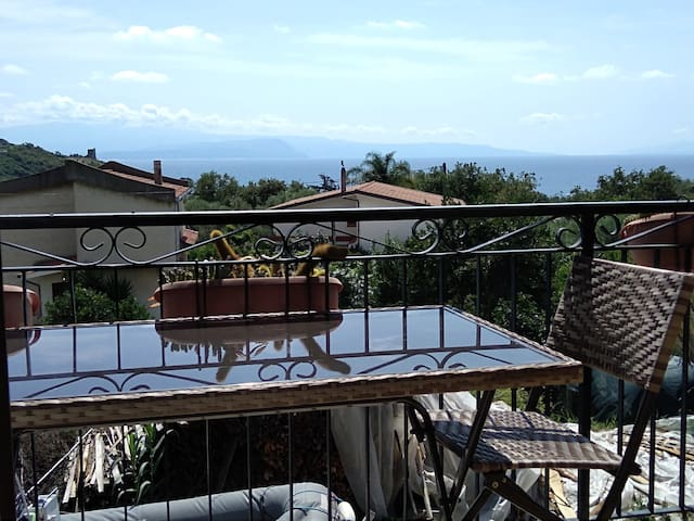 Balcony with table and seaview