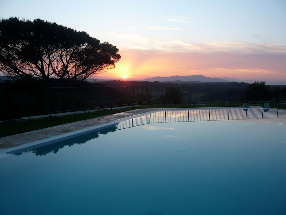 Sunset over the Tuscan countryside as seen from our pool