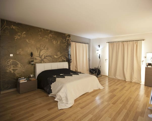 Spacious sunny relaxing master bedroom