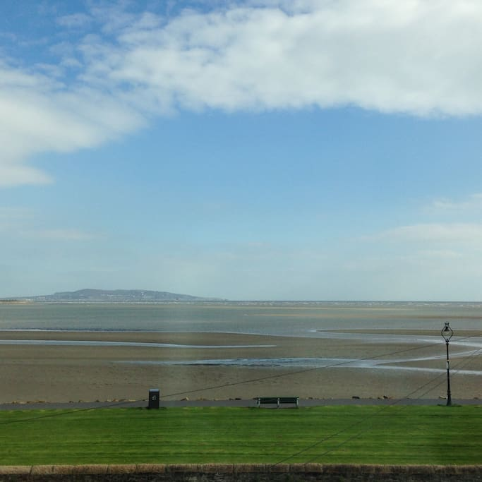 View from the bedroom window over Dublin Bay. Here the tide is half -way.