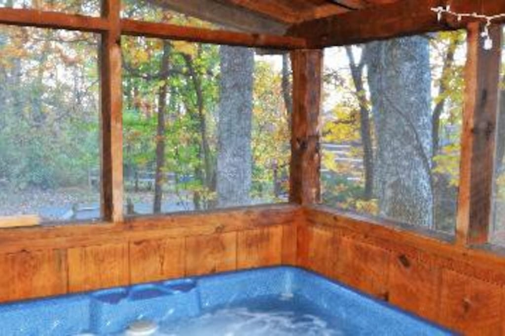 Hot Tub is on screened in porch