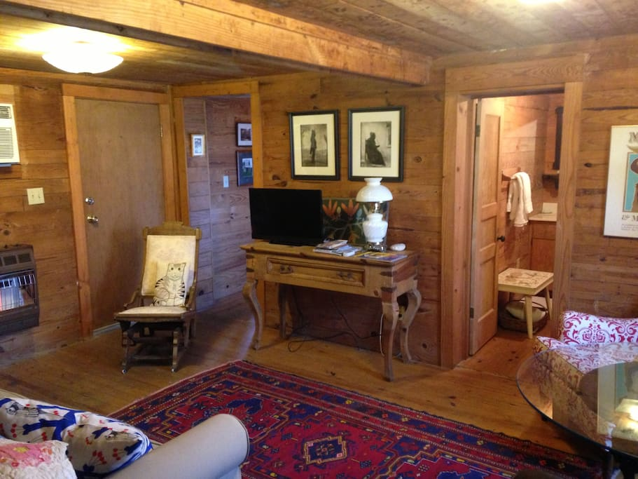 The cabin has wifi and the downstairs living area has cable TV. The foldout sofa (bottom left) is queen-sized.