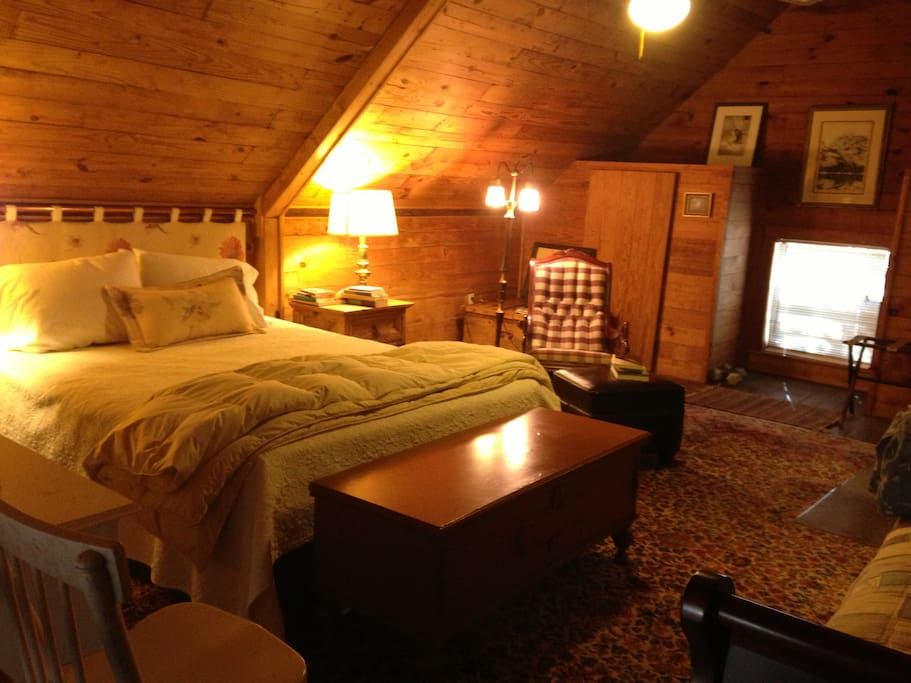 The upstairs loft is spacious enough for a queen bed, a daybed and a comfy rocker.