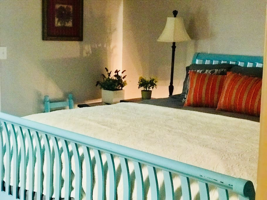 Our King-sized bed in the spacious bedroom with bedside lamps and chargers for your devices make it easy to relax. Additional bedding provided with inflatable queen mattress  or couch. Sheets and cozy blankets provided for all.  Room for 5 guests.