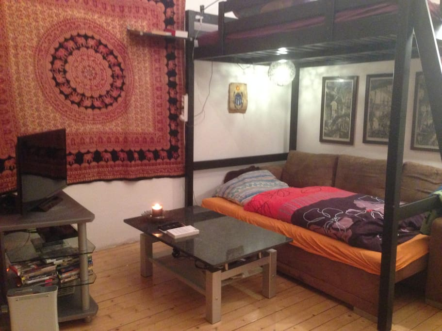 1st room with 2 double beds (one on the ground and one loft bed) and TV