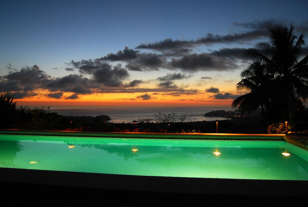 A sunset from the dining room table! ...looking over the pool and the bay of Samara