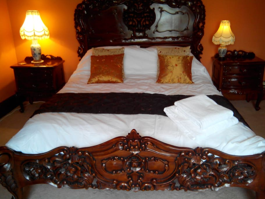 Rococo style king size bed in bedroom 2.