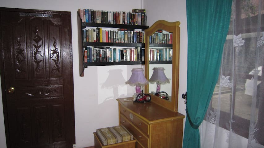 Master bedroom. View on left side with Make Up Corner, small library and hair dryer and door to bath room.