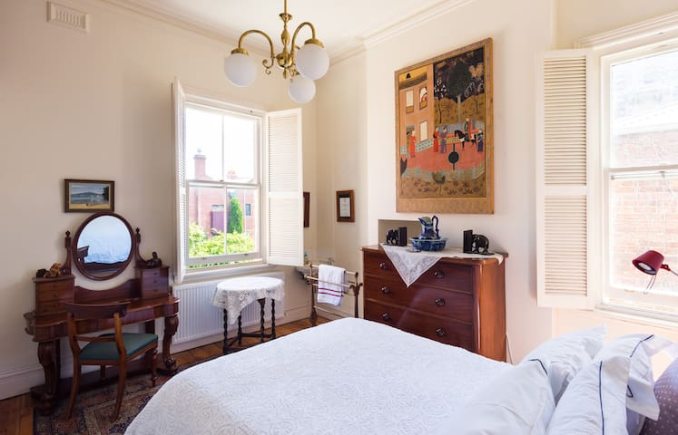 .This second large bedroom has a quality queen mattress and the windows overlook a lush garden.