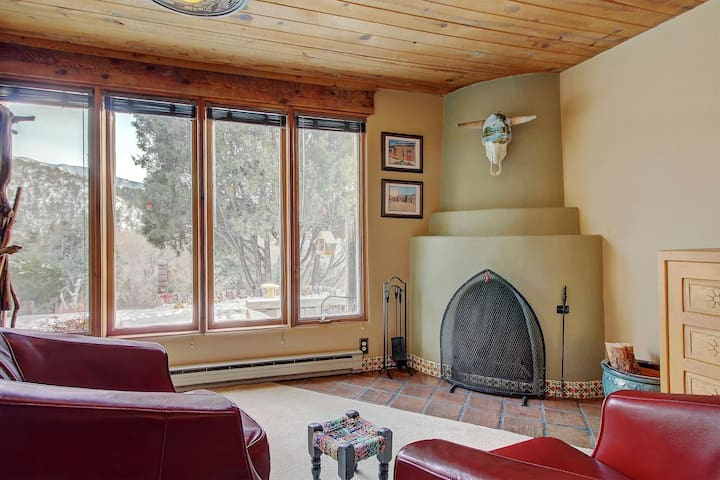 Sitting area has Kiva fireplace and view of Valdez Valley