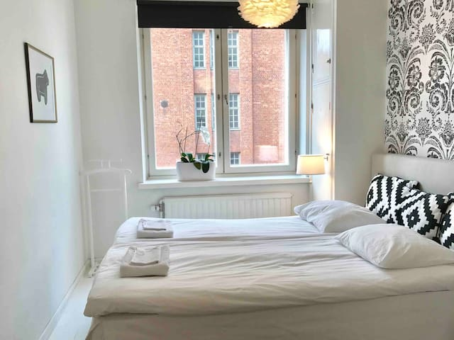 A cute bedroom in city center