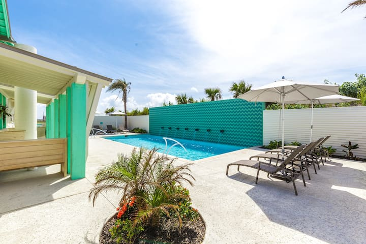 Relax at the shared adult pool, featuring lounge chairs and shaded cabanas.
