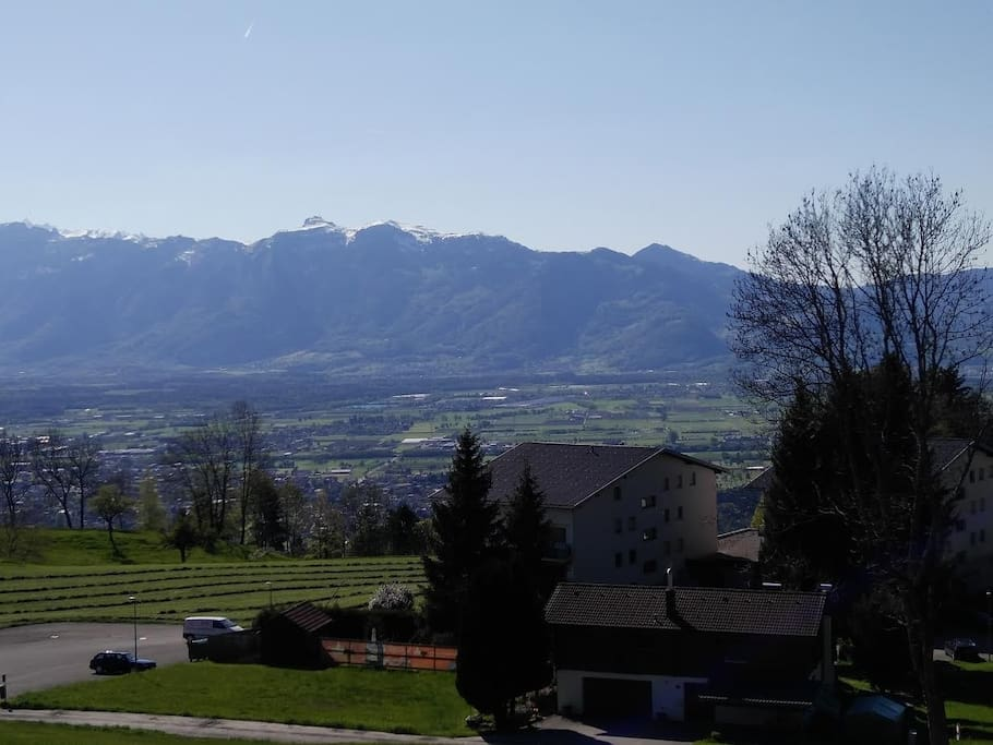 The view, from outside, over the Rhine valley to the Swiss mountains