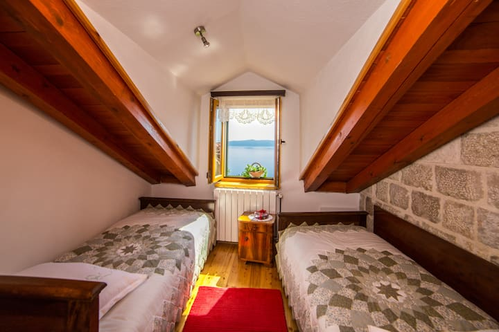 Bedroom in the attic,with high quality wood furniture,and extra quality mattres