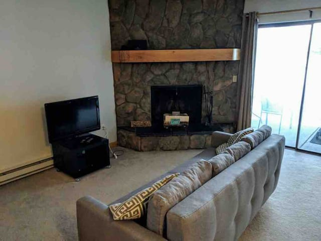 Cozy living room with fold down couch & wood burning fire