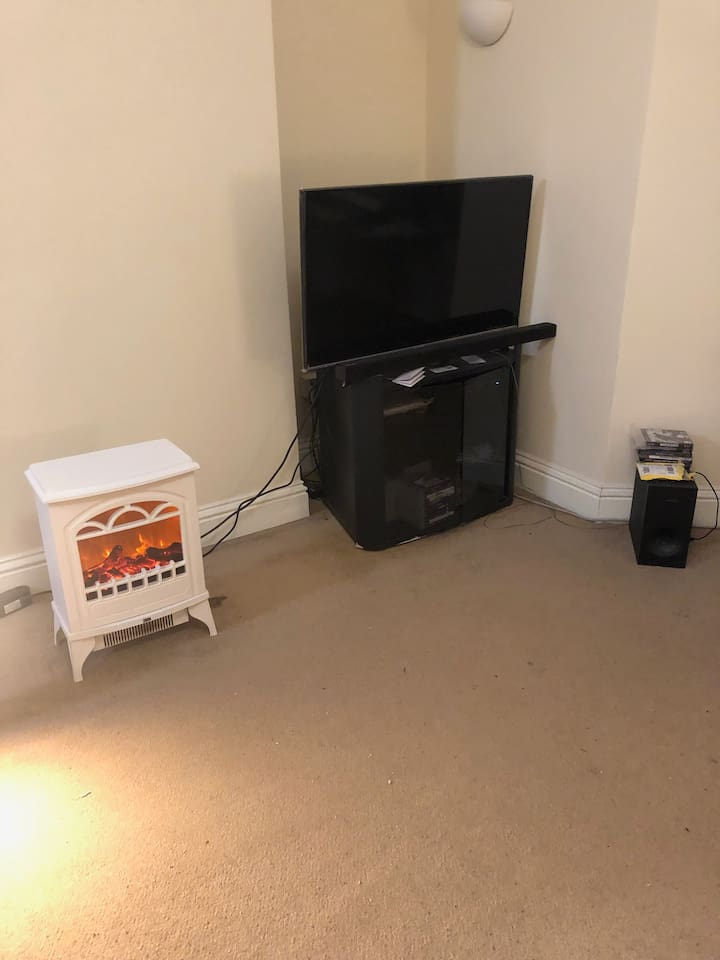 This the front room, which also includes a heater, 40 inch plus HD TV with virginmedia box, PS3 console  and a sofa bed