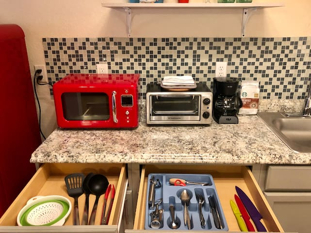 Cooking utensils, knives, silverware, can, wine and bottle opener, and pasta strainer included. Coffee and sugar always available for you.
