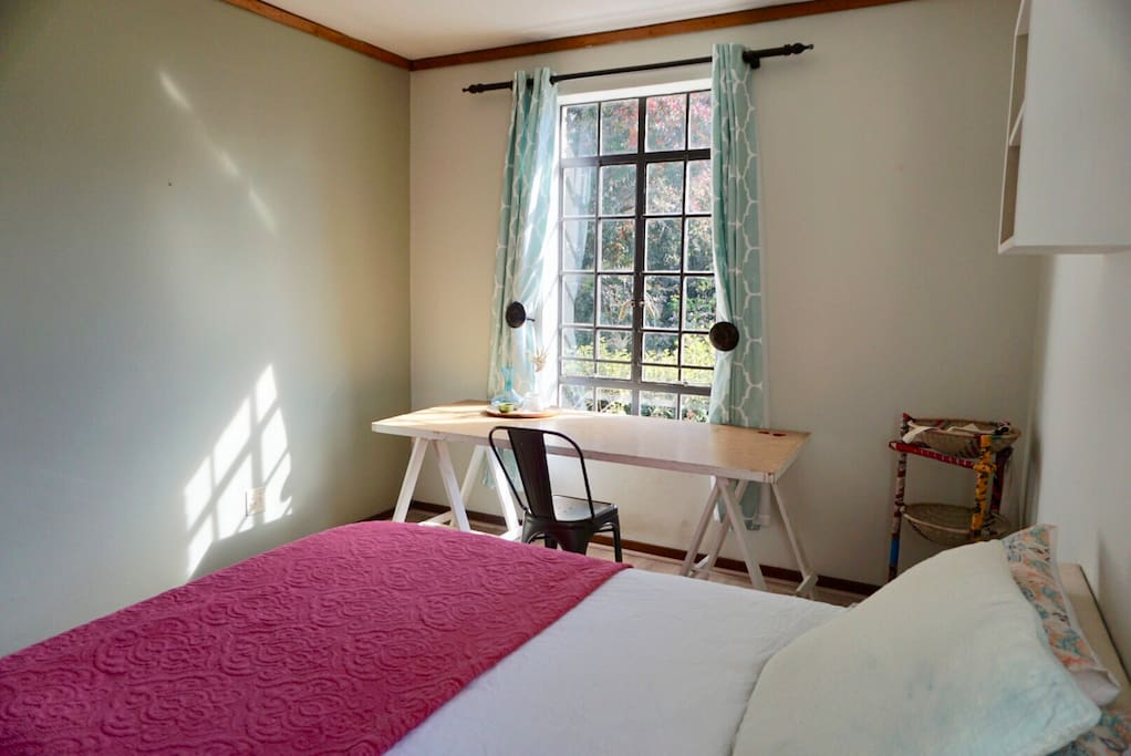 1st view of private guest room; double bed (100% cotton linen, chiropractic bed), desk with a view.