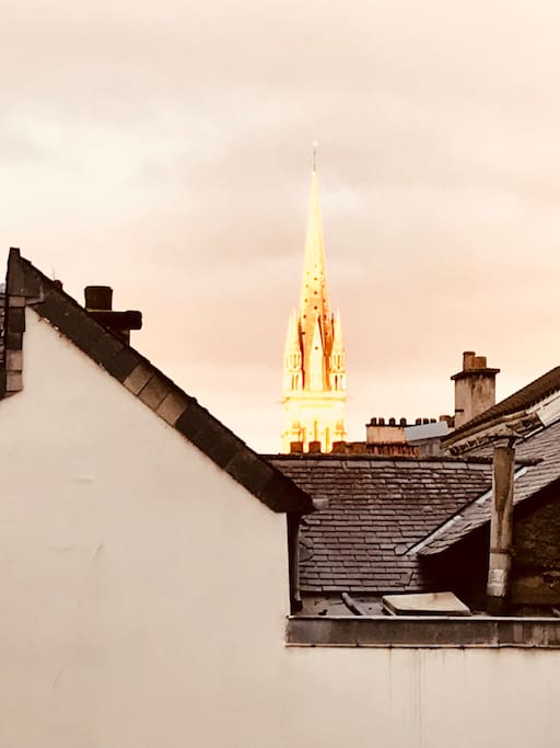 An amazing ray of gold on the spire of Eglise St Martin this morning! A zoomed in view from the bedroom window