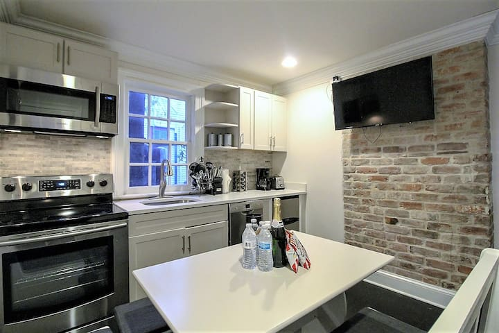 Cozy kitchen has wall mounted TV