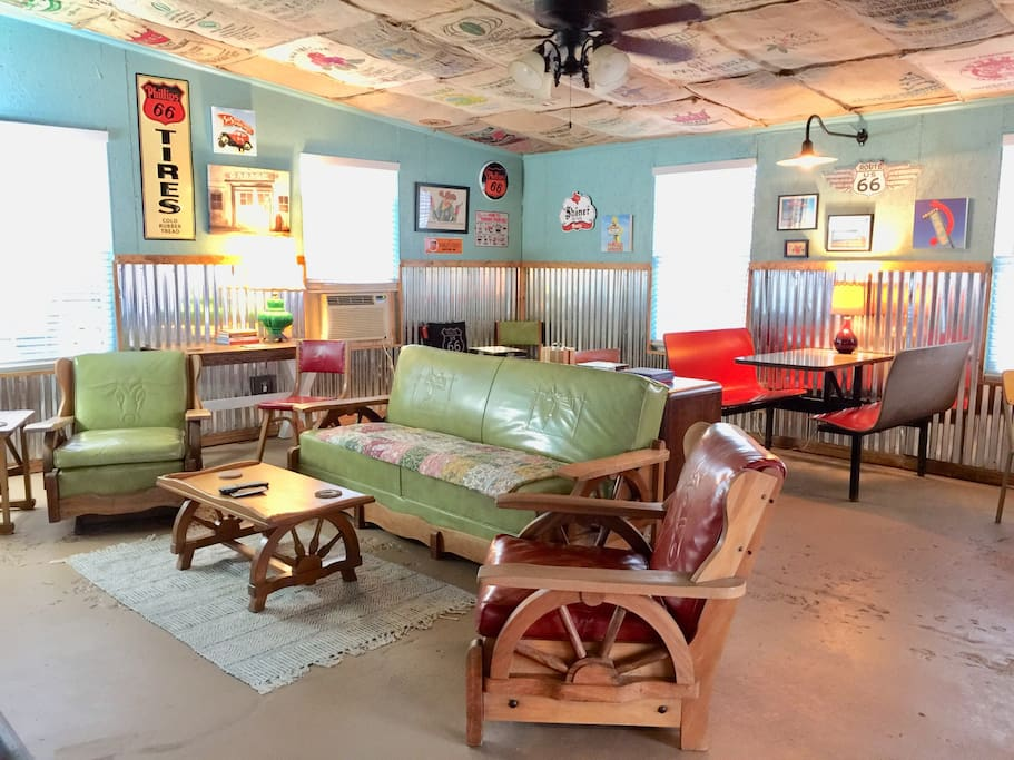 Fun game room with vintage furnishings, including 50's western wagon wheel sofa and chairs.
