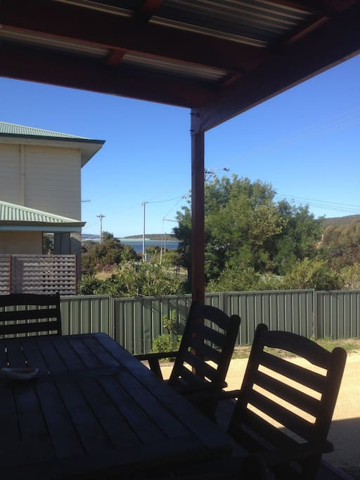 Water views across the river to the beach from beautiful new jarrah front deck, complete with outdoor seating and BBQ for a relaxing time with family or friends.