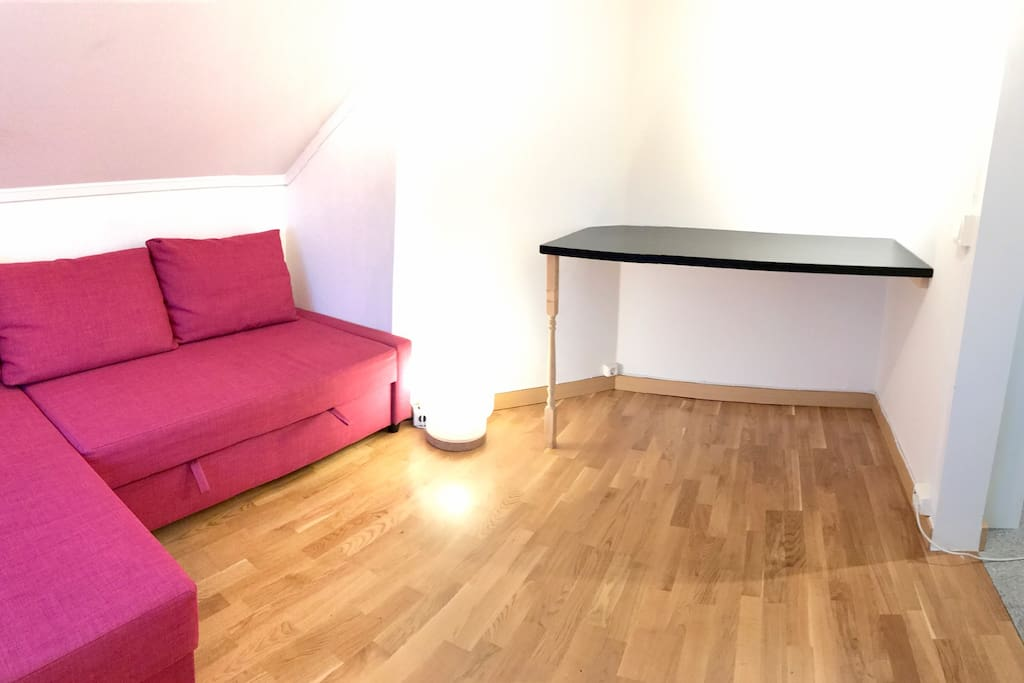 Bedroom.  Bright and spacious. Double bed and table.