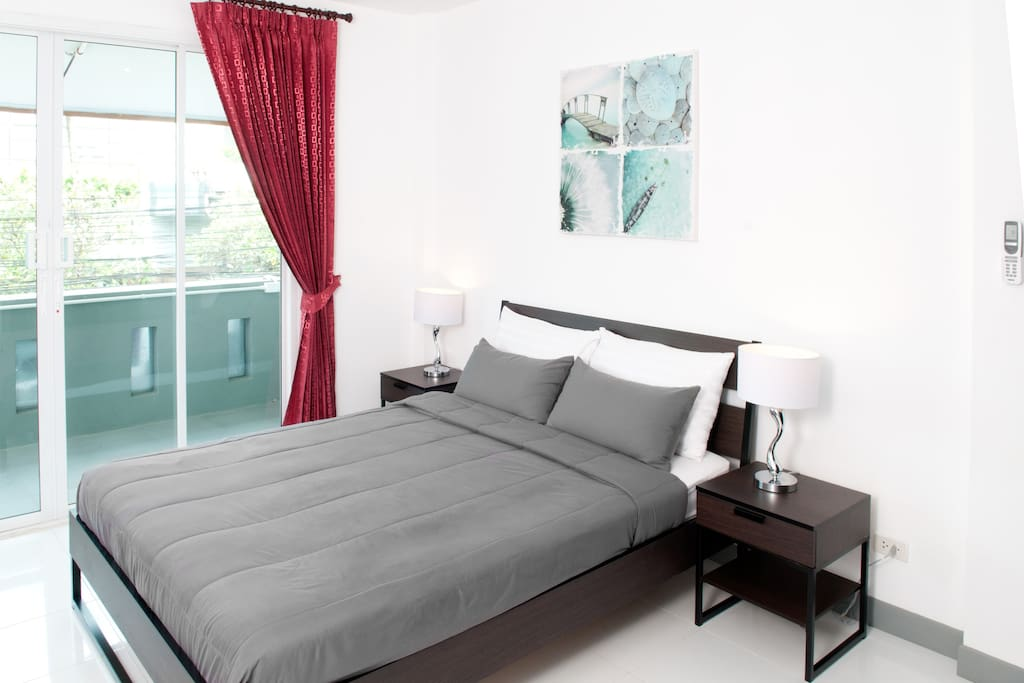 Close up of bed and bedside tables. Very comfortable mattress and soft cotton sheets.