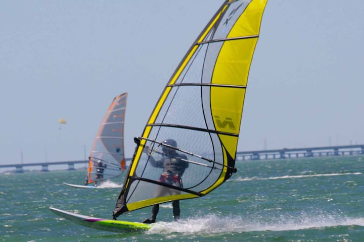 The wind here is perfect for windsurfing, kiteboarding, or simply flying a kite.
