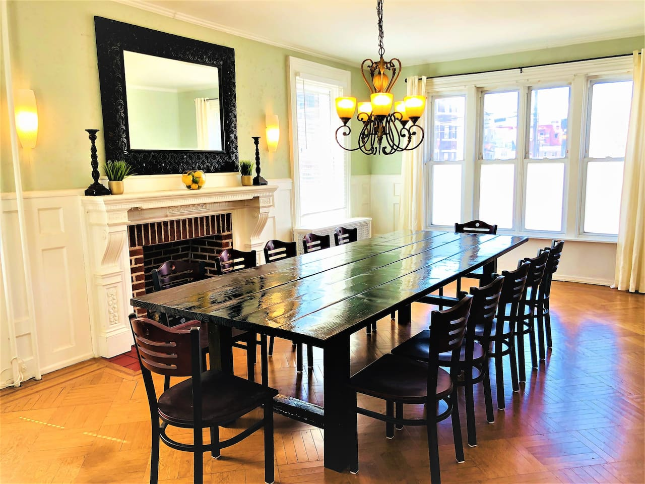 """Relax and gather at the dining table with seating for 14!  Oh yes, and there's a 50"""" flat screen in this room if you want to watch a sporting event or other program while you're gathered together.  And it's a Smart TV!"""