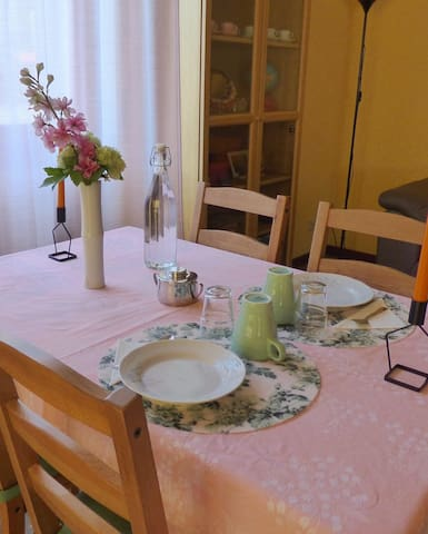 The Living-room w/ table ready for breakfast