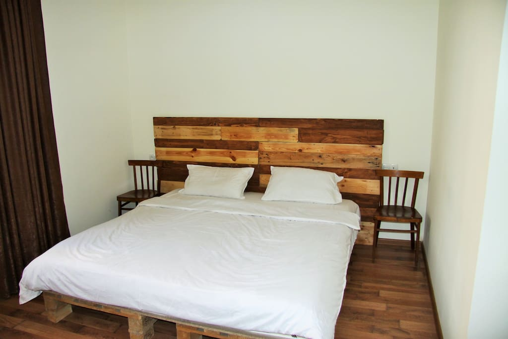 Handmade wooden quin size bed for two