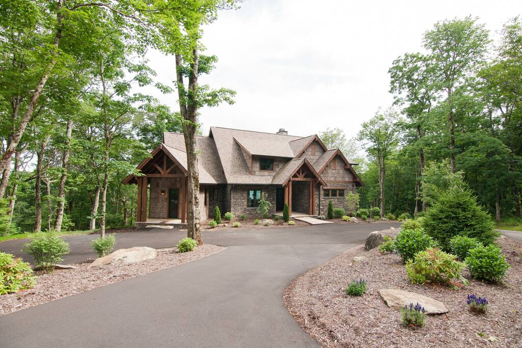 Beautiful landscaping and a paved driveway.
