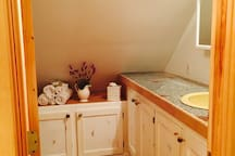 Full bathroom with granite counter tops and a shower (not shown). We provide shampoo, organic Texas hand made soap (our gift to you), a hair drier, plus all other  bathroom amenities..