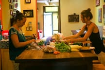 """We host plant-based cooking classes highlighting the local produce in our fully-equipped kitchen with beautiful butcher block island workspace. Check out the """"Other Things to Note"""" section for class details."""