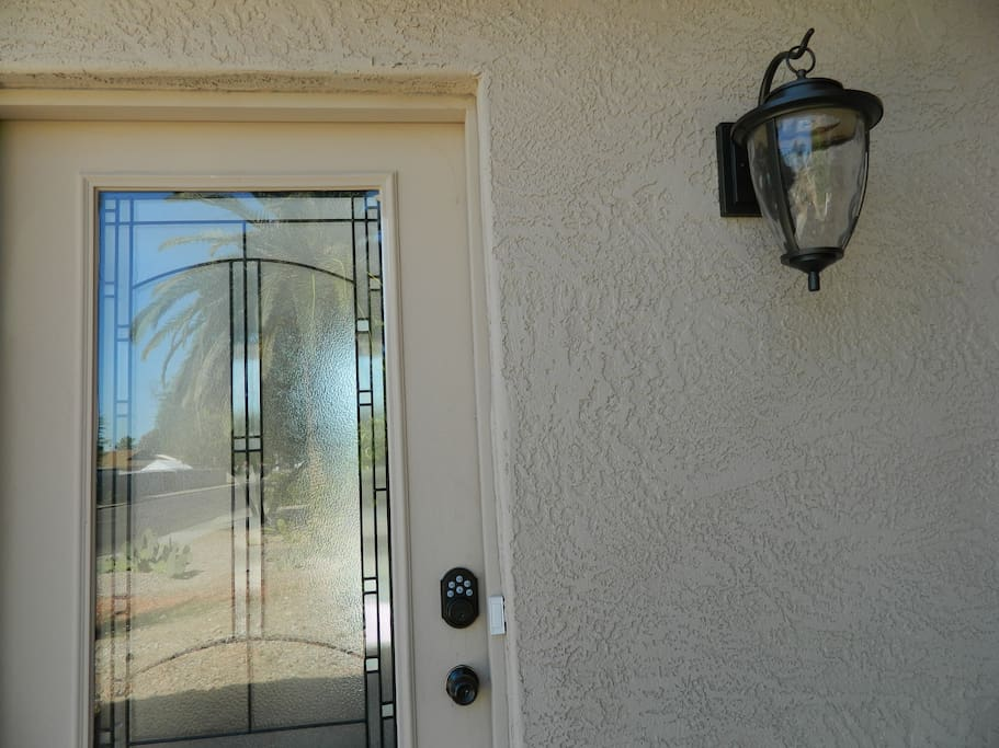 Conveniently park infront of this front entry with combination lock for easy access. No worries about losing keys!