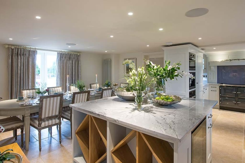 Open plan kitchen and dining space with miele oven, steam oven and coffee maker