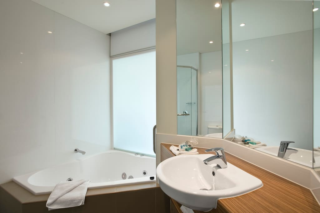 Bathroom with spa and seperate shower area