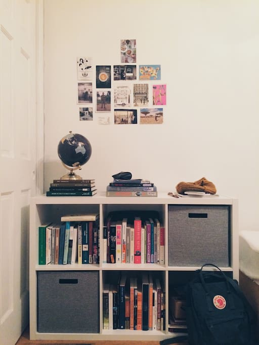 The bookcase & the postcard wall.