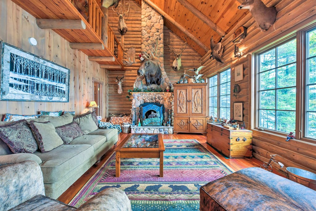 The cabin boasts a 2,000-square-foot living space with rustic decor.